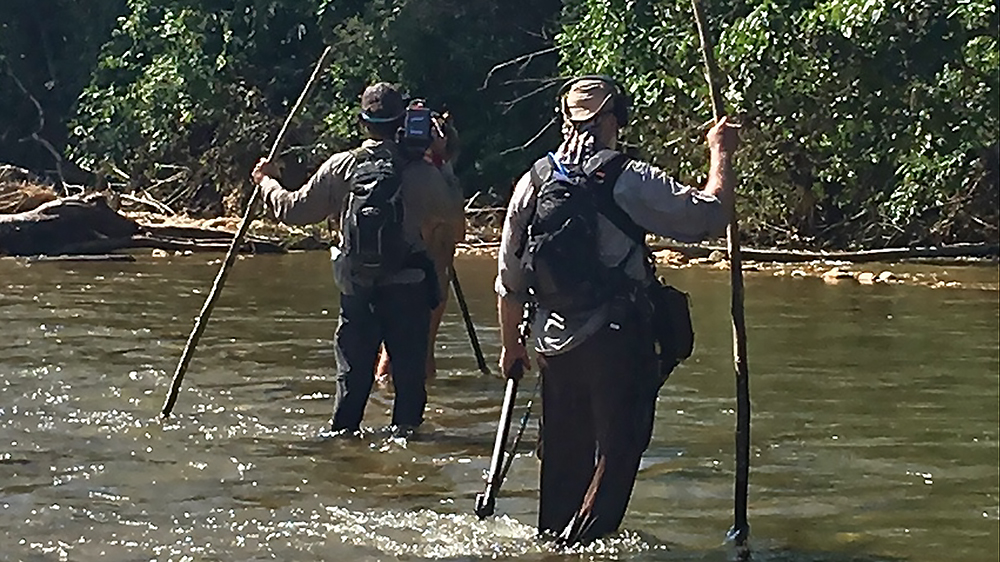 Jeff Deeth crossing a river for Naked and Afraid episode